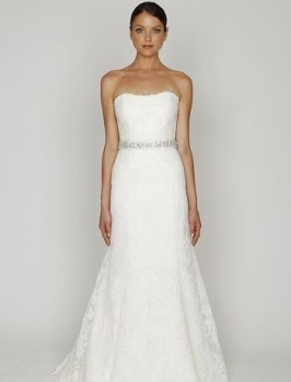 Bliss by Monique Lhuillier Style 32292385 Strapless A-Line Gown in Lace This a-line gown features a strapless neckline with a natural waist in lace and embroidery. It has a sweep train. This gown is available in Plus Sizes