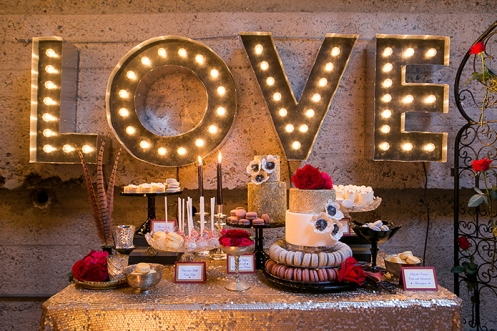 parisian-circus-wedding-luce-loft-reception-with-gold-sequins-dessert-table-and-love-marquee-sign.jpg